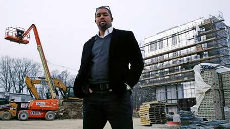 Architect Jonathan Garland poses for a photo on