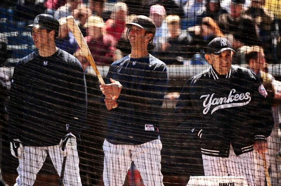New York Yankees' Mark Teixeira, Jorge Posada and