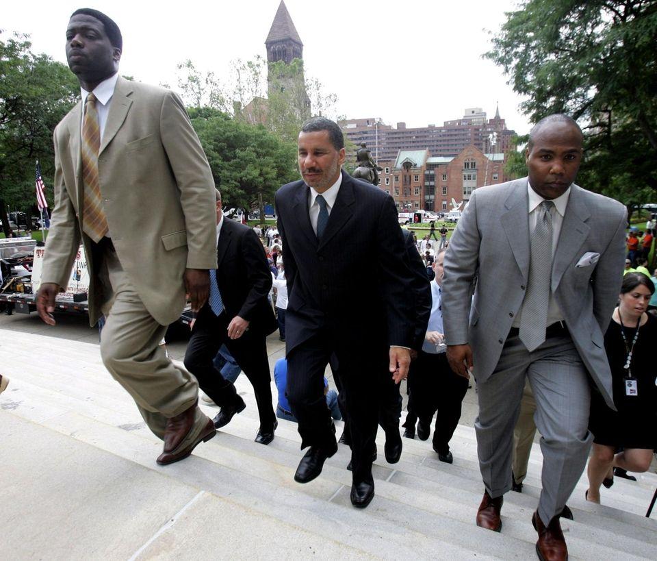 Gov. David A. Paterson, center, walks up the