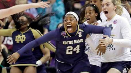 Notre Dame's Arike Ogunbowale, No. 24, is congratulated
