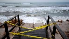 A staircase is blocked off as storm erodes