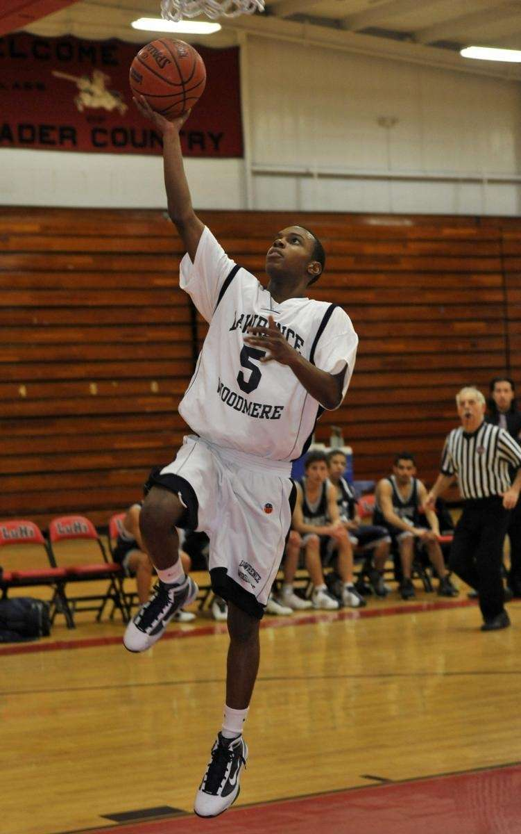 Lawrence Woodmere's Edwin Sainvil shoots uncontested during his