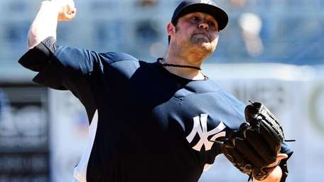 New York Yankees' Joba Chamberlain pitches during