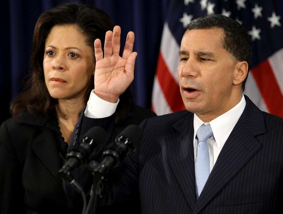FILE - Governor David Paterson raised his hand