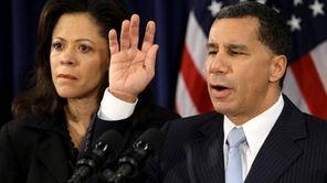 FILE - Governor David Paterson raised his hand
