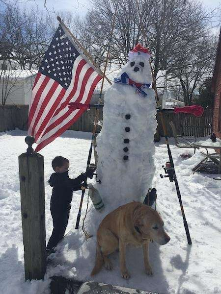 Liam Brown making giant snowman with Penny