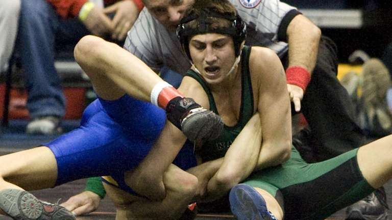 Syosset's Nick Arujau goes for the pin against