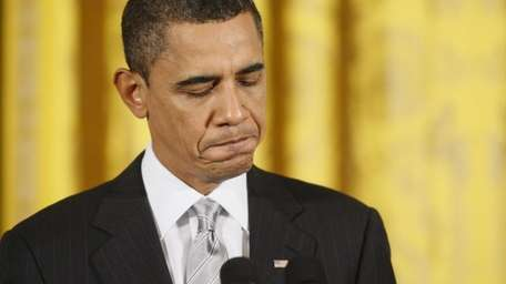 President Barack Obama pauses while speaking before he
