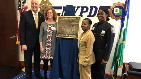 NYPD Chief of Detectives Robert Boyce with families