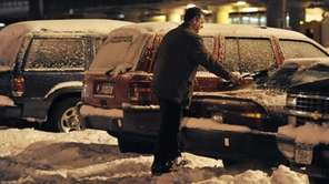 =Frank Lennon of Levittown stands in a snow-