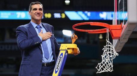 Villanova head coach Jay Wright cuts down the