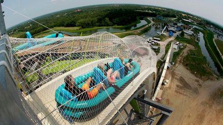 "Riders go down the water slide called ""Verruckt"""