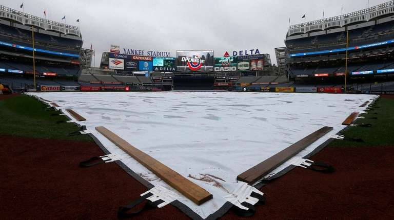 The tarp covers the field before the Opening