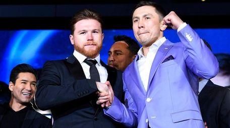 Canelo Alvarez (L) and Gennady Golovkin pose during