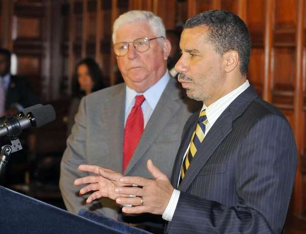 Gov. David Paterson, right, speaks as Richard Ravitch,