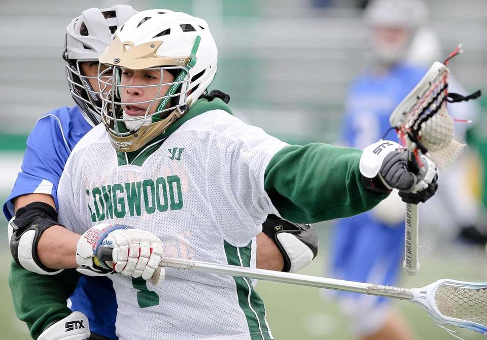 Longwood's Abel Almonte tries to get away from