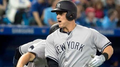Yankees' Tyler Austin rounds third after hitting a