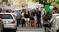 Marchers protest the fatal police shooting of the