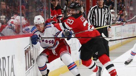 Vladislav Namestnikov of the Rangers is hit into