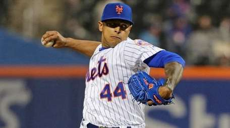 The Mets' AJ Ramos delivers a pitch during