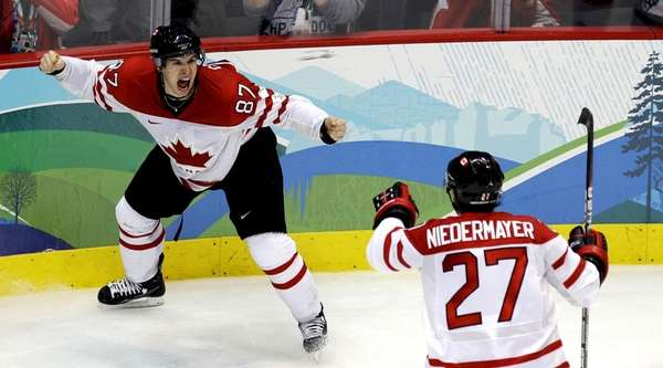 Canada's Sidney Crosby, left, celebrates with Scott Niedermayer