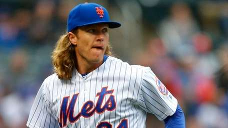 Mets pitcher Noah Syndergaard looks on after the