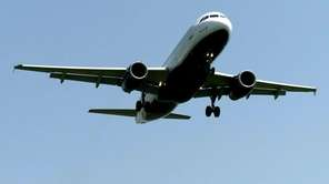 A plane lands on runway 22 at John