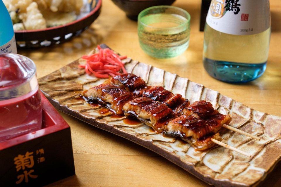 Unagi kogushi yaki, or skewers of barbecued eel,