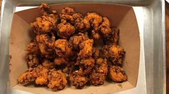 Hearty nuggets of fried alligator are among the