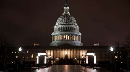 The Capitol is seen before dawn Wednesday after