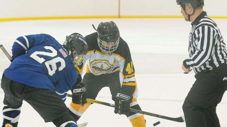 Wantagh-Seaford center #47 Andrew Friedman, right, faces off