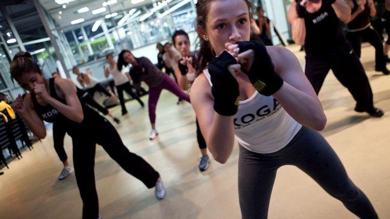 Stephanie Zeis helps lead an exercise class called