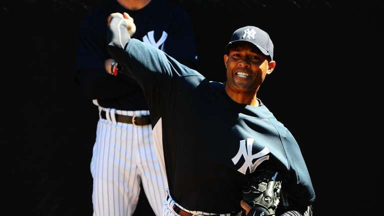 Mariano Rivera throws during spring training at George