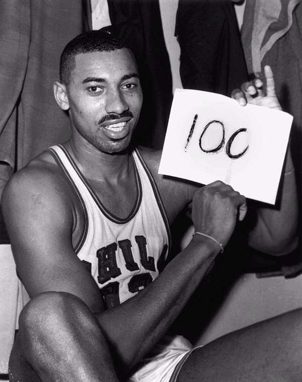 Wilt Chamberlain of the Philadelphia Warriors holds a