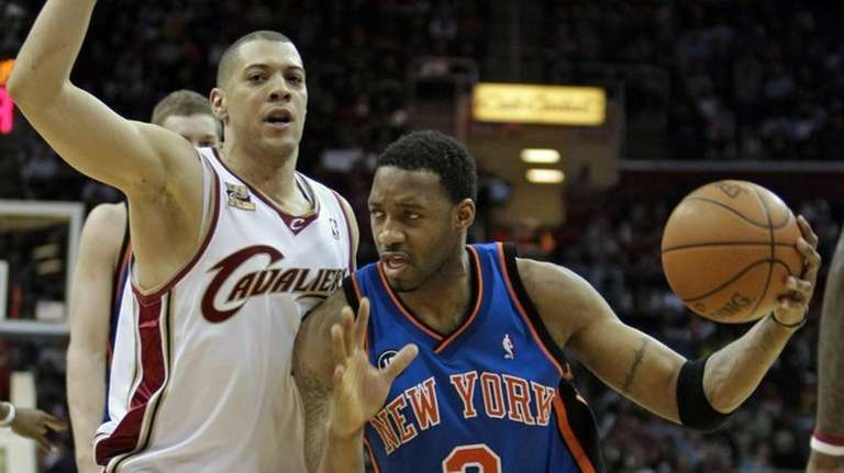 New York Knicks guard Tracy McGrady, right, drives