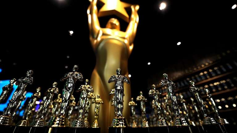 Replicas of Oscars' statues are on display in