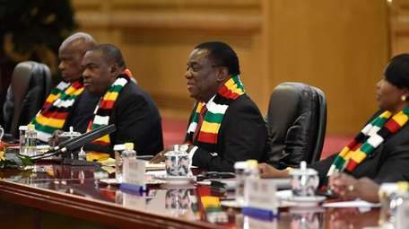 Zimbabwean President Emmerson Mnangagwa, second from right, who