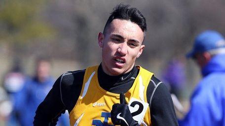 East Meadow's Keith Hernandez wins the 1,600 meters
