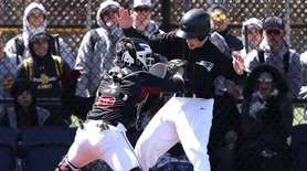 Sachem East's Ryan Micheli #8 makes the tag