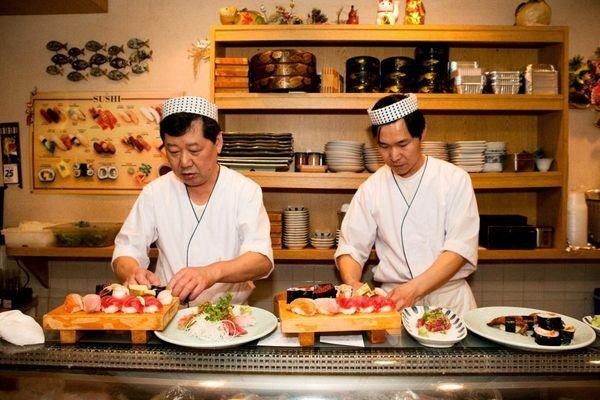 Akira Yamaguchi and his staff prepare sushi for