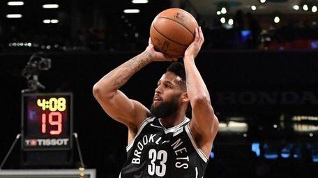 Nets guard Allen Crabbe shoots against the Toronto