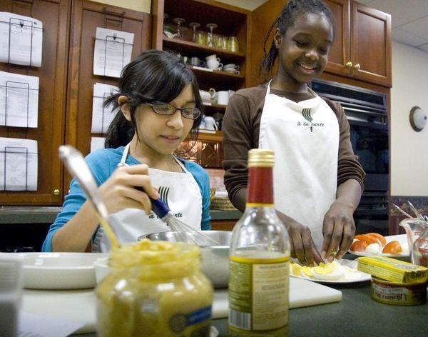 Deyanira Jacome, 12, with friend Bryanna Brown, 12,