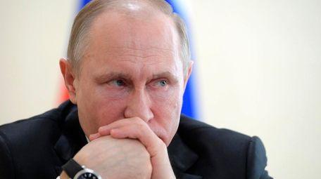 Russian President Vladimir Putin attends a meeting in