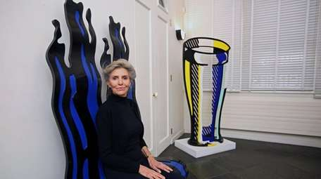 Dorothy Lichtenstein sits on her late husband's work,