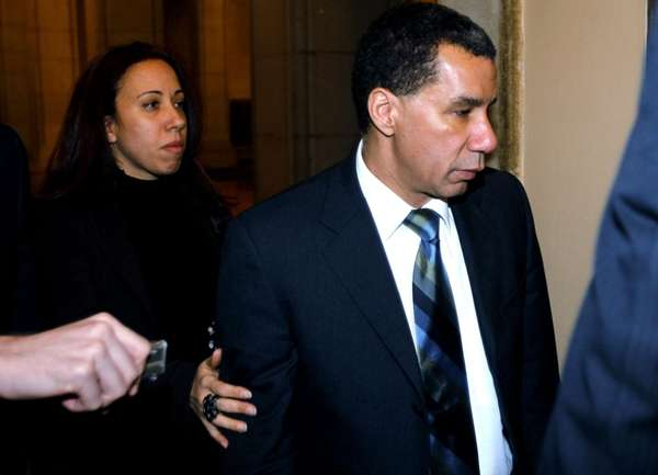 Gov. David Paterson walks in a hallway at