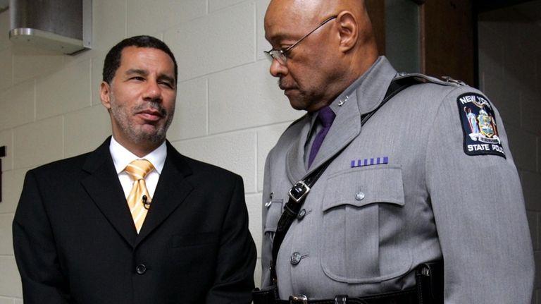 Gov. David Paterson, left, talks with State Police