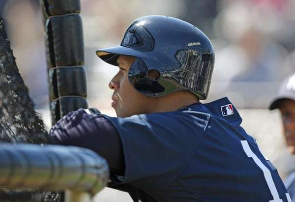 New York Yankees Alex Rodriguez stands behind the