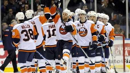 The Islanders line up to congratulate themselves after