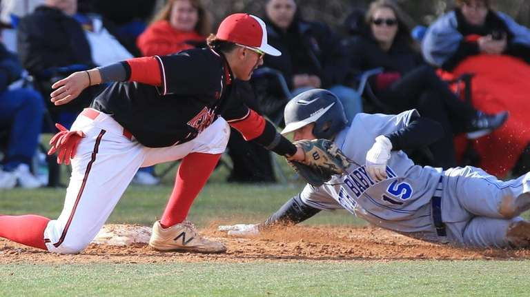 Newfield's Dylan Johnson makes the tag on North