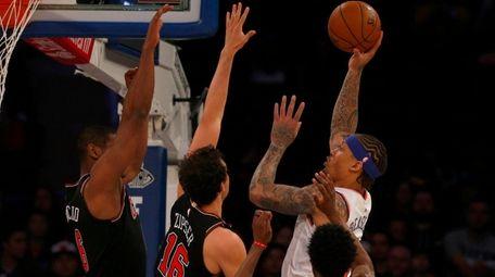 Michael Beasley of the York Knicks puts up